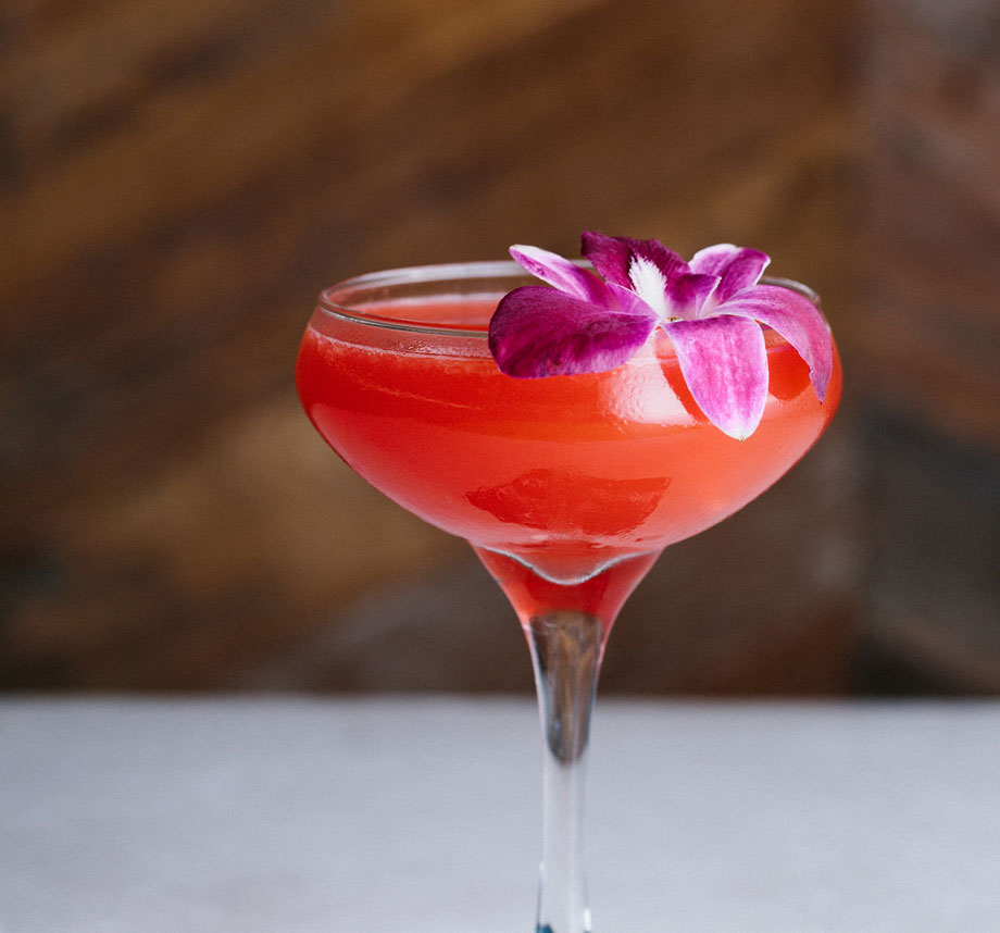 pink cocktail with purple flower